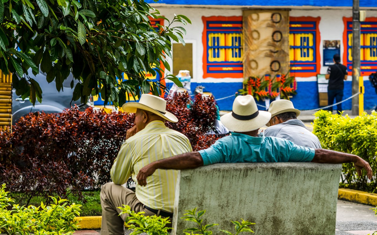 Colombians on a bench in the main square of Filandia in Colombia